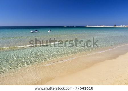 Ayia Napa beach with jetskis on crystal clear water - stock photo