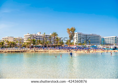 AYIA NAPA, CYPRUS - April 04, 2016: People swimming and sunbathing on the picturesque Nissi beach.