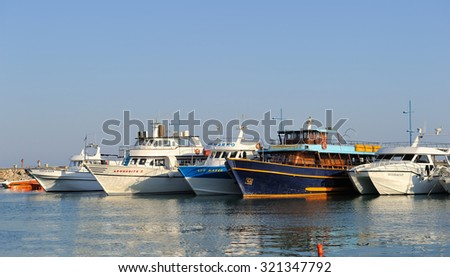 Ayia Napa, Cyprus - September 3, 2015: Boats and yachts at anchor in bay fishing in the city of Ayia Napa