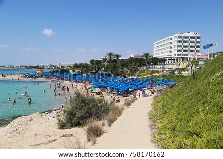 AYIA NAPA, CYPRUS - SEPTEMBER 7, 2017: People on the beach in Ayia Napa, Cyprus