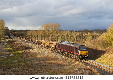 AYLESBURY, UK - JANUARY 15: An EWS operated freight train heads to Didcot with a returns MOD diagram on January 15, 2015 in Aylesbury. EWS now owned by DBS is the largest UK rail freight operator