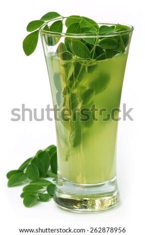 Ayurvedic Juice made from moringa leaves over white background - stock photo