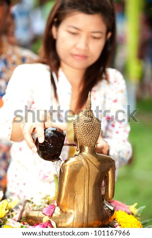 AYUTTAYA,THAILAND-APRIL 13 : People showering buddha statue in Songkran festival in temple,Ayuttaya,Thailand. - stock photo