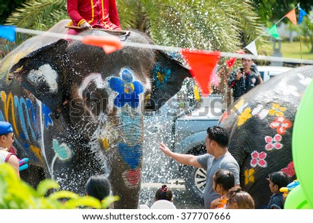 AYUTTHAYA, THAILAND - APR 13:  Revelers and elephants join in water splashing during Songkran Festival on Apr 13, 2015 in Ayutthaya, Thailand.  The festival has long been observed as Thai New Year