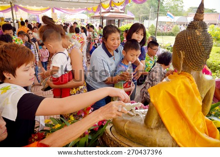"Ayutthaya, THAILAND - APRIL 13, 2015: Unidentified Thai people water pouring to Buddha statue in ""Songkran Festival 2015(water festival)"" at temple in Ayutthaya, THAILAND - stock photo"
