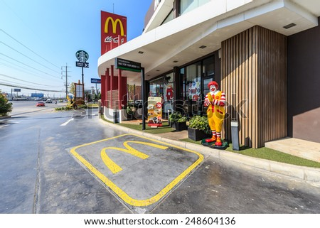 AYUTTHAYA, THAILAND - DEC 26: McDonal's facade at Wangnoi on Dec 26, 2014 in Ayutthaya. It's the world's largest chain of hamburger fast food restaurants, serving around 68 million customers daily. - stock photo