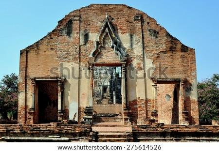 Ayutthaya, Thailand - December 20, 2010:  Brick entrance facade of the Ubosot sanctuary hall ruins at Wat Ratchaburana - stock photo