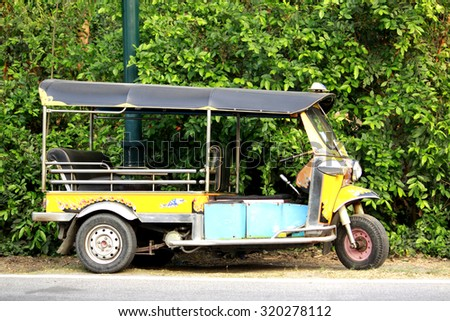 AYUTTHAYA-THAILAND-FEBRUARY 15 : A Tuk Tuk car near the road on February 15, 2015 At Ayuthaya Province, Thailand.