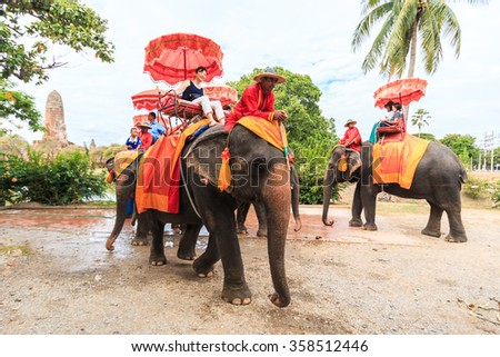 AYUTTHAYA, THAILAND - JULY 25: Tourists an elephant ride tour of the ancient city on June 25, 2015 in Ayutthaya.