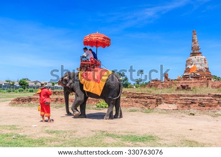 AYUTTHAYA, THAILAND - JUNE 1: Tourists on an elephant ride tour of the ancient city on June 1, 2015 in Ayutthaya.