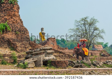 AYUTTHAYA, THAILAND - March 17, 2016:Tourists on an elephant ride tour of the ancient city Ayutaya a visit to the historic site and behind the Wat Chang Temple on March 17,2016, Ayutthaya, Thailand.