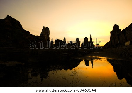 AYUTTHAYA, THAILAND -NOVEMBER 7: flooded Historical Temple in Ayutthaya, during the monsoon season Thailand on November 7, 2011. - stock photo