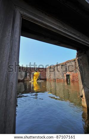 AYUTTHAYA, THAILAND - OCTOBER 17: flooded  Historical Temple in Ayutthaya, during the monsoon season Thailand on October 17, 2011. - stock photo