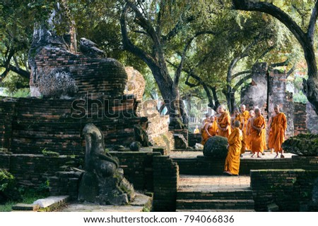 Ayutthaya, Thailand - October 10, 2017: Thai little monks is traveling at Wat Mahathat, Ayutthaya, Thailand