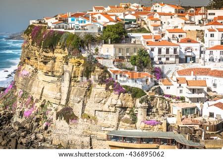 Azenhas do Mar white village landmark on the cliff and Atlantic ocean, Sintra, Lisbon, Portugal, Europe. - stock photo