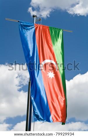 Azerbaijani flag over blue sky - stock photo
