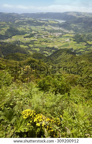 Azores landscape with Furnas lake and village from Salto Cavalo. Vertical - stock photo