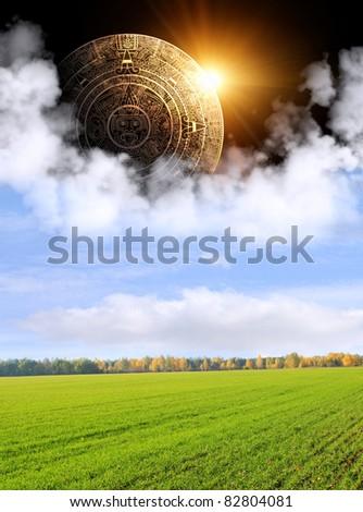 Aztec calendar and autumn landscape - stock photo