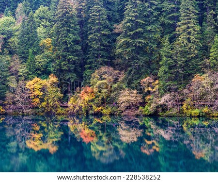 Azure lake. Jiuzhaigou Valley was recognize by UNESCO as a World Heritage Site and a World Biosphere Reserve - China - stock photo