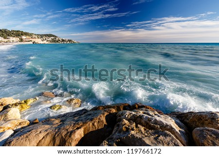 Azure Sea and Beuatiful Beach in Nice, French Riviera, France - stock photo