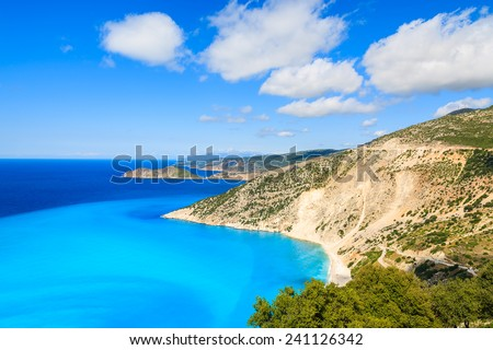 Azure sea water of beautiful Myrtos bay and beach on Kefalonia island, Greece - stock photo