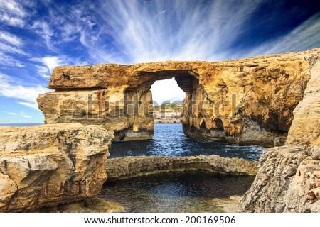 Azure Window, famous stone arch of Gozo island in the sun in summer, Malta - stock photo