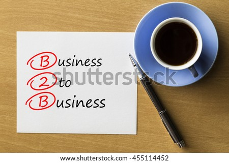 B2B Business To Business - handwriting on notebook with cup of coffee and pen, acronym business concept