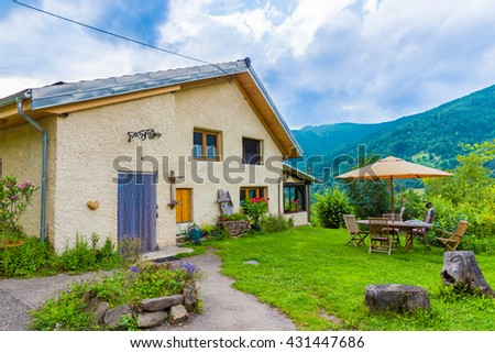 B&B Las Trinquades with view of the Pyrenees and a little garden and table and chairs in Boussenac in France - stock photo