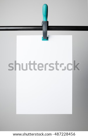 B1-Blank poster hanging on A Clamp, ready to replace your design.