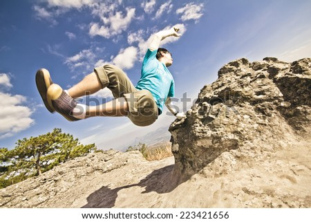 B-Boy action on the mountain - stock photo