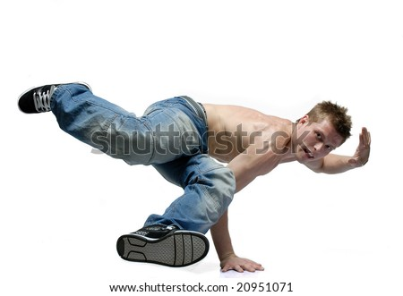 B-boy dancer standing on one arm with lifted legs left arm lifted up - stock photo