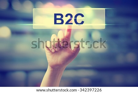 B2C concept with hand pressing a button on blurred abstract background