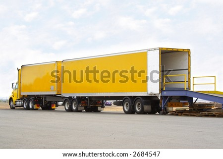 B double truck backed onto loading dock - stock photo