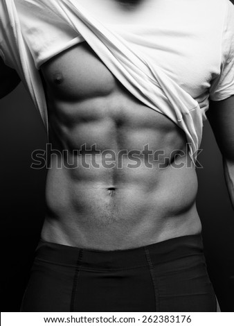 B/w closeup photo of an athletic guy with perfect abs - stock photo