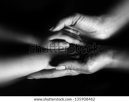 B/W Hands mother and baby close-up