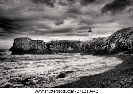 B&W of lighthouse on coast in Newport, Oregon. - stock photo