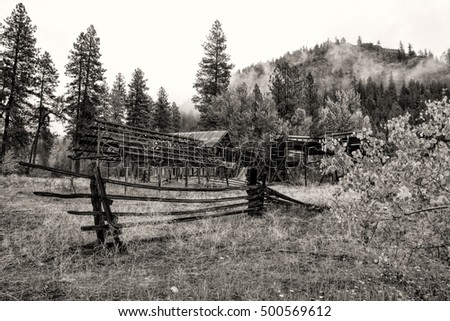 B&W of old barn and fence in Okanogan county in Washington near Winthrop.