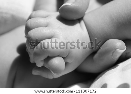 B&W photo of new-born baby - stock photo