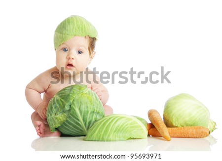 babe in an environment of the fresh vegetables, isolated on the white - stock photo