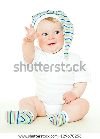 babe in striped socks and hat - stock photo