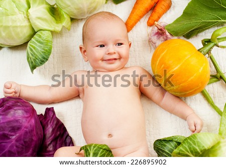 babe with vegetables - stock photo