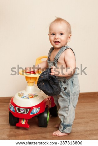 Babies and toy car at home. Driving. - stock photo