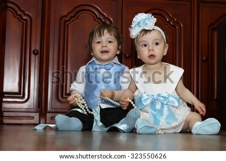 babies in the suit boy and girl twins - stock photo