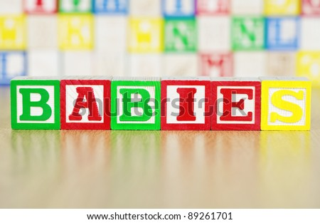 Babies Spelled Out in Alphabet Building Blocks - stock photo