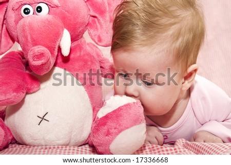 baby and elephant - stock photo