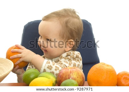 Baby and fresh fruits on table isolated background