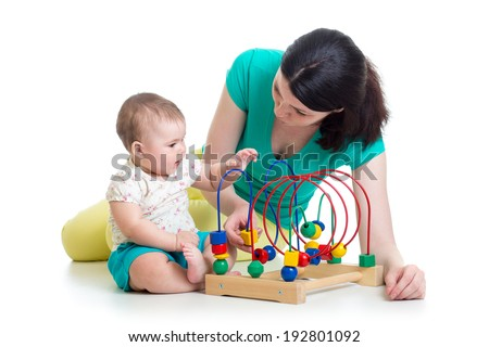 baby and mom play with color educational toy - stock photo