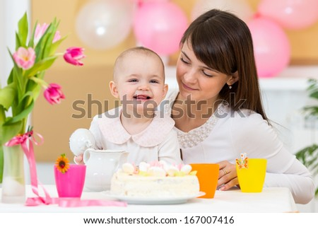 baby and mother celebrating first birthday - stock photo