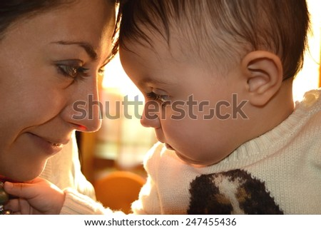baby and mother hug - stock photo