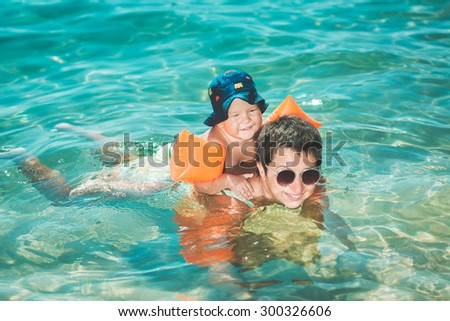 Baby and mother in a sea - stock photo